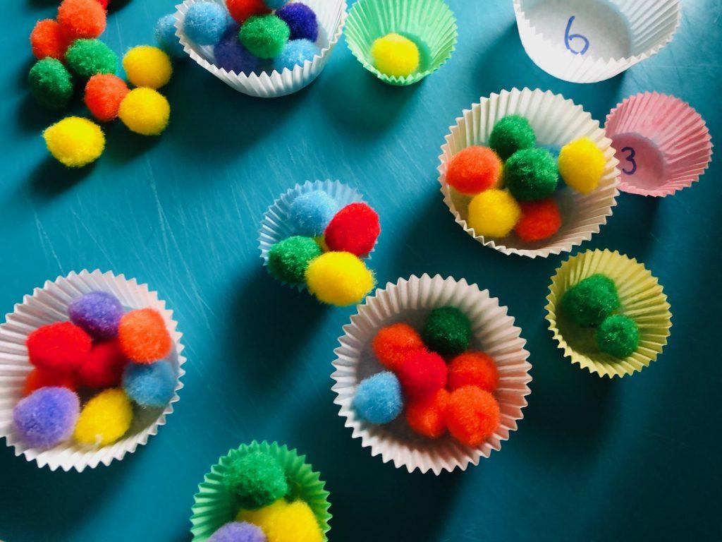 Pom Poms in cupcake cases