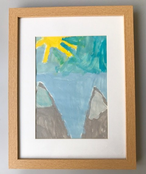 Children's artwork in a frame - kids and clutter